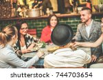 happy trendy friends drinking... | Shutterstock . vector #744703654