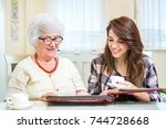 grandmother and granddaughter... | Shutterstock . vector #744728668