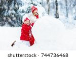children build snowman. kids... | Shutterstock . vector #744736468