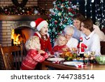 family with children eating... | Shutterstock . vector #744738514
