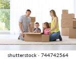 happy family unpacking... | Shutterstock . vector #744742564