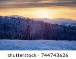 sunset in mountains  winter...   Shutterstock . vector #744743626