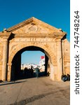 Small photo of Fez, Morocco- February 6, 2015: Pose of people walking and admiring old gates and walls of Fez castle in Morocco.