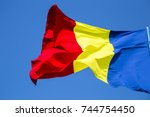 romanian flag on the mast.... | Shutterstock . vector #744754450