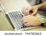 man uses laptop for coding... | Shutterstock . vector #744782863