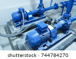 blue water pump on floor | Shutterstock . vector #744784270