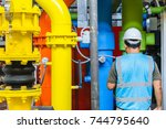 engineer doing routine check... | Shutterstock . vector #744795640