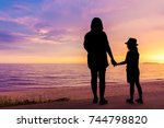 silhouette of asian mother and...