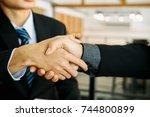 asian businessman handshake and ...   Shutterstock . vector #744800899