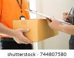 woman appending signature on... | Shutterstock . vector #744807580