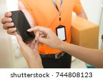 woman hand signing in mobile... | Shutterstock . vector #744808123