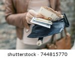 woman holding in hands wallet... | Shutterstock . vector #744815770