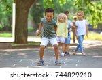 Little Children Playing Hopscotch Outdoors - Fine Art prints