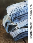 various colors jeans stacked on ... | Shutterstock . vector #744839476