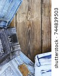 various colors jeans on a... | Shutterstock . vector #744839503
