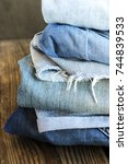 various colors jeans stacked on ... | Shutterstock . vector #744839533