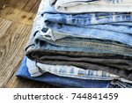 various colors jeans stacked on ... | Shutterstock . vector #744841459