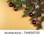 christmas background with fir... | Shutterstock . vector #744850720