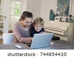 woman using laptop indoors with ...   Shutterstock . vector #744854410