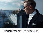 side view of gentleman in... | Shutterstock . vector #744858844