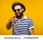 young hipster man in sunglasses ... | Shutterstock . vector #744860350
