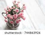 bouquet of pink roses in a vase ... | Shutterstock . vector #744863926