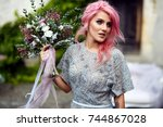 stunning woman with pink hair... | Shutterstock . vector #744867028