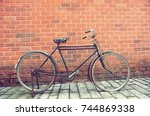 old bicycle on roadside with... | Shutterstock . vector #744869338