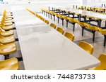 Stock photo empty seats and tables in the clean cafeteria at the elementary school 744873733