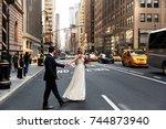 bride holds groom's hand... | Shutterstock . vector #744873940