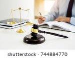 gavel and soundblock of justice ...   Shutterstock . vector #744884770