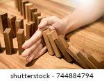 Businessman Hand Stop Dominoes...