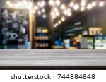 empty wooden table and room... | Shutterstock . vector #744884848