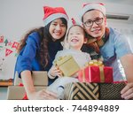 asian young family on christmas ... | Shutterstock . vector #744894889