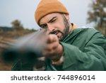 handsome hunter aiming at...   Shutterstock . vector #744896014