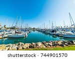 oceanside harbor on a clear day ... | Shutterstock . vector #744901570