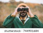 handsome man in hat and... | Shutterstock . vector #744901684
