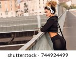 beautiful jogger urban portrait ...   Shutterstock . vector #744924499