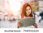 young beautiful female traveler ... | Shutterstock . vector #744931024