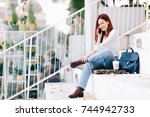 young woman sitting at the... | Shutterstock . vector #744942733