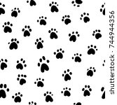 paw print seamless. traces of... | Shutterstock .eps vector #744944356
