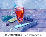 Small photo of A cup of tea with lemon, a thermometer and tablets on a wooden table, snowing. Prevention of colds and flu. Cold toned