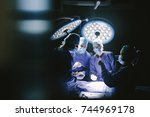 group of surgeons in operating... | Shutterstock . vector #744969178