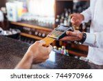 customer making payment using... | Shutterstock . vector #744970966