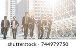 business people running in city ... | Shutterstock . vector #744979750