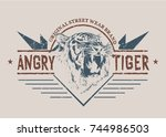 angry tiger graphic retro label.... | Shutterstock .eps vector #744986503
