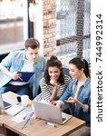 aspiring man and two girls... | Shutterstock . vector #744992314