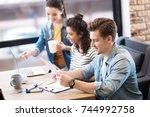 content man holding a sheet of... | Shutterstock . vector #744992758