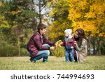 a young family walks in the...   Shutterstock . vector #744994693