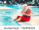 santa claus near the pool... | Shutterstock . vector #744998326